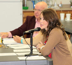"""<div class=""""source"""">Ben Hyatt</div><div class=""""image-desc"""">WKYT news anchor Amber Philpott served as the guest moderator during Sunday's debate hosted by the Harrison County TEA Party at the Extension Office. Also pictured is Darwin Root.</div><div class=""""buy-pic""""><a href=""""/photo_select/20518"""">Buy this photo</a></div>"""