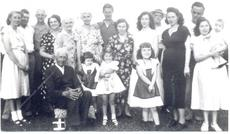 """<div class=""""source""""></div><div class=""""image-desc"""">1950's Picture 1st Row: Lloyd Struve, Diane Price, Charlene Hall, Phyllis Price. Back Row: Gladys Hall, Carol Hall, Leonardy Struve, Lola Struve, Anna Struve, Blanche Price, Paul Price, Eileen Price, Margaret Price, Mr. Swartz, Naomi Swartz, Charles Price, Chuck Price being held by mother Mildred Price. </div><div class=""""buy-pic""""><a href=""""/photo_select/14976"""">Buy this photo</a></div>"""