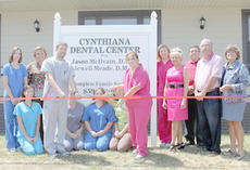 "<div class=""source"">Kristie Hamon</div><div class=""image-desc"">Drs. Jason McIlvain and Jewell Meade cut the ribbon with the Cynthiana Chamber of Commerce announcing the official opening of the Cynthiana Dental Center. The Center is located at 111 Ky. Hwy. 32 W (Connersville Pike) in Suite 2.</div><div class=""buy-pic""><a href=""/photo_select/19282"">Buy this photo</a></div>"