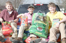 """<div class=""""source"""">Ben Hyatt</div><div class=""""image-desc"""">The Harrison County Middle School FFA chapter raised over 950 pounds of dry animal food to donate to the Harrison County Food Pantry. The Food Pantry is currently working with the Harrison County Humane Society in an effort to provide pet food to owners who cannot afford food for their pets. The goal is for the food drive to decrease the number of pets that are turned over to the Harrison County Animal Shelter due to lack of funds to keep pets. Pictured in the back of the truck is FFA members Tristan Ellington, Austin Snapp and Ben Northcutt. The top donation was made by Tractor Supply of Cynthiana. """"Thank you to all of those from the Middle School that donated pet food to the drive,"""" said Middle School FFA advisor Erin Butler. """"I know that the economy is hurting right now but it is truly humbling to see how much a community can come together to support each other.""""</div><div class=""""buy-pic""""><a href=""""/photo_select/17916"""">Buy this photo</a></div>"""