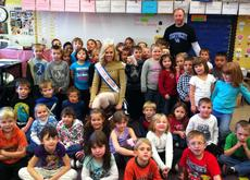 """<div class=""""source""""></div><div class=""""image-desc"""">Katie Himes, Miss Kentucky Collegiate 2012, recently visited the kindergarten classes at Southside Elementary. She gave a presentation on bullying to the students, read the story of Cinderella, and shared some of her personal experiences. Himes is pictured with the kindergarteners, along with Southside principal Steven Fowler. Himes is the daughter of Bob and Cathy Himes.</div><div class=""""buy-pic""""></div>"""