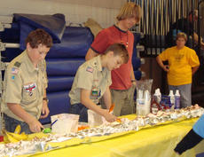 """<div class=""""source""""></div><div class=""""image-desc"""">Members of Troop 76 assisted Blue Grass Council with the Tiger Fun Day held at the Pavilion Oct. 6. Pictured are Henry DeRolf, Drew Dorsey, and Timmy Lail. Activities for the Tigers (Cub Scouts) included swimming, a relay obstacle course, steal the bacon, parachute, and a huge banana split.</div><div class=""""buy-pic""""></div>"""