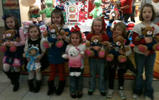 """<div class=""""source""""></div><div class=""""image-desc"""">Girl Scout Troop #765 visited Build A Bear Saturday as a troop. They each made a Daisy Girl Scout Bear of their own and one to donate to St Jude's Hospital for a sick child. The bears were purchased with money the girls earned from selling cookies last January. Pictured from left, are, Karlie Gatrost, Maddyson Shaw , Sophia Weisgerber, Layla Vance, Chloe Vance, Breanna Gann, and Sydney Click.</div><div class=""""buy-pic""""></div>"""