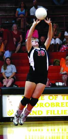 """<div class=""""source"""">courtesy of Donald Richie/Richie's Photography</div><div class=""""image-desc"""">Junior Ashley McCarty sets the ball Monday night in the Fillies' volleyball home opener against Powell County.</div><div class=""""buy-pic""""><a href=""""/photo_select/11021"""">Buy this photo</a></div>"""