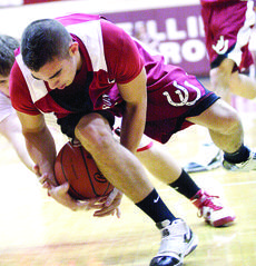 """<div class=""""source"""">courtesy of Donald Richie/Richie's Photography</div><div class=""""image-desc"""">Corey Nichols fights for the loose ball against Pendleton County. The District 38 final went neck and neck for most of the game, with the Wildcats outlasting the Breds, 55-49. Nichols came off the bench and scored eight. The Breds' record now stands at 16</div><div class=""""buy-pic""""><a href=""""/photo_select/10485"""">Buy this photo</a></div>"""