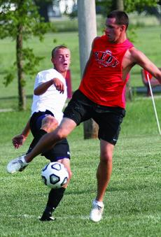 "<div class=""source"">courtesy of Donald Richie/Richie's Photography</div><div class=""image-desc"">Former Bred Ilan Bear works to keep the ball away from current sophomore Kyle Foster Friday in the annual alumni soccer game in the Breds alumni versus current players soccer game at Lebus Field.</div><div class=""buy-pic""><a href=""http://web2.lcni5.com/cgi-bin/c2newbuyphoto.cgi?pub=081&orig=SC-foster-bear_8260.jpg"" target=""_new"">Buy this photo</a></div>"