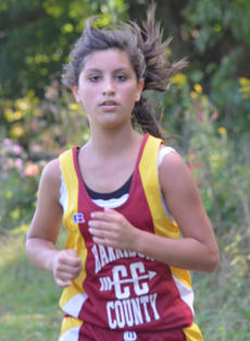 "<div class=""source""></div><div class=""image-desc"">Jesse Petty competed in the middle school girls 4000M race.</div><div class=""buy-pic""></div>"