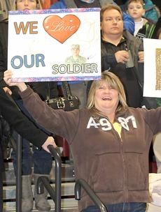 """<div class=""""source""""></div><div class=""""image-desc"""">Hundreds of family and friends gathered with signs in support for their beloved troops.</div><div class=""""buy-pic""""><a href=""""/photo_select/21812"""">Buy this photo</a></div>"""