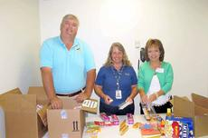 """<div class=""""source"""">Ben Hyatt</div><div class=""""image-desc"""">Harrison County Judge-Executive Alex Barnett, Harrison Memorial Hospital employee Michele Fulton and Kathy Brown of Cedar Ridge packed donated items to be sent to the 149th Vertical Engineering Group which is currently serving in Afghanistan.</div><div class=""""buy-pic""""><a href=""""http://web2.lcni5.com/cgi-bin/c2newbuyphoto.cgi?pub=081&orig=Soldier%2BSupport%2B6.6.13.jpg"""" target=""""_new"""">Buy this photo</a></div>"""