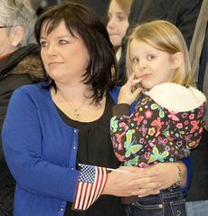 """<div class=""""source""""></div><div class=""""image-desc"""">A mother and daughter looked on as awards were presented to some of the soldiers.</div><div class=""""buy-pic""""><a href=""""/photo_select/21817"""">Buy this photo</a></div>"""
