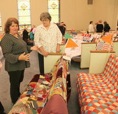 """<div class=""""source"""">Betsy Smith</div><div class=""""image-desc"""">Jenny Tapp and Vicki Purcell admire a quilt at Cynthiana Baptist Church's Mission Celebration and Quilt Show on Saturday.</div><div class=""""buy-pic""""><a href=""""/photo_select/42877"""">Buy this photo</a></div>"""