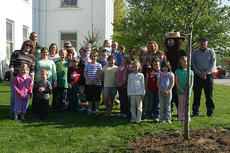 """<div class=""""source"""">Robin Smiley</div><div class=""""image-desc"""">arbor/earth day. Luke Saunier, Forest Ranger with the Kentucky Division of Forestry, presented a program on Kentucky Arbor Day, April 7 and Kentucky Earth Day, April 22 at the Cynthiana-Harrison County Public Library. A Cleveland Pear, donated by Bruin Landscaping, was planted on the courthouse lawn. Smokey the Bear (Glendon King of the Cynthiana Fire Department) and Randy Herrington, also of the Cynthiana Fire Department, made a special appearance for the program. Each child in attendance received a Yellow Poplar tree.</div><div class=""""buy-pic""""><a href=""""http://web2.lcni5.com/cgi-bin/c2newbuyphoto.cgi?pub=081&orig=arbor.earthDay.612.jpg"""" target=""""_new"""">Buy this photo</a></div>"""