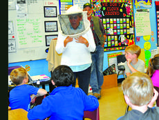 "<div class=""source"">Josh Shepherd</div><div class=""image-desc"">Beekeeper Jane Thomas demonstrates to first grade students the bee keeper suit that she wears when she is handling the bees in her own hives. The children were as fascinated with the suit as they were the bee hive.</div><div class=""buy-pic""><a href=""http://web2.lcni5.com/cgi-bin/c2newbuyphoto.cgi?pub=081&orig=bees_southside.jpg"" target=""_new"">Buy this photo</a></div>"
