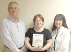 "<div class=""source""></div><div class=""image-desc"">On May 1, the Bourbon/Harrison Kentucky Agency for Substance Abuse Policy (KY-ASAP) board members, Ronnie Spicer (Board Chair) and Lisa Doyle (Vice Chair) presented Jessica Tumey with a plaque for recognition of 10 years of outstanding service on the Board. Tumey is also a past Chair of the Board. The mission of KY-ASAP is to promote the reduction of alcohol, tobacco and other drug use and abuse through the implementation of comprehensive research-based strategies.</div><div class=""buy-pic""></div>"