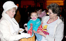 """<div class=""""source""""></div><div class=""""image-desc"""">Mrs. Claus (Donna Keith) handed out treats for those who attended the first official tree-lighting at the Harrison County courthouse Friday night. The event kicked off a weekend of Christmas festivities that included the parade and visits with Santa on Saturday.</div><div class=""""buy-pic""""><a href=""""/photo_select/21219"""">Buy this photo</a></div>"""