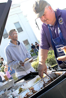 """<div class=""""source"""">Becky Barnes</div><div class=""""image-desc"""">Harrison County Judge Executive Alex Barnett served up pulled pork sandwiches and grilled cabbage to the visitors at his booth on Saturday. Barnett was one of three contestants in the annual BBQ Cook-off hosted by Champions for a Drug-Free Harrison County. Barnett finished in second place behind David Turner and his pulled pork and beef brisket.</div><div class=""""buy-pic""""><a href=""""/photo_select/20697"""">Buy this photo</a></div>"""