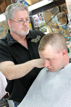 """<div class=""""source"""">Becky Barnes</div><div class=""""image-desc"""">Cynthiana Rod Run organizer Jerry Adams clips Caleb Conley's hair Monday afternoon at his shop on Oddville Avenue. Adams was honored as the Chamber of Commerce's Volunteer of the Year.</div><div class=""""buy-pic""""><a href=""""/photo_select/23118"""">Buy this photo</a></div>"""