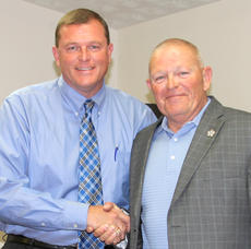 "<div class=""source"">Josh Shepherd</div><div class=""image-desc"">Shain Stephens is expected to be sworn in on Aug. 1 as Harrison County Sheriff, taking over for the retiring Bruce Hampton, right. Hampton has served Harrison County for 25 years as sheriff.</div><div class=""buy-pic""><a href=""http://web2.lcni5.com/cgi-bin/c2newbuyphoto.cgi?pub=081&orig=c.shain_.bruce_9346_0.jpg"" target=""_new"">Buy this photo</a></div>"