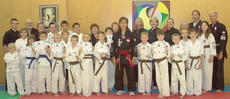 """<div class=""""source""""></div><div class=""""image-desc"""">Members of the Cynthiana Sin The' Shaolin Karate Club who tested and advanced to the next belt level were, front row, from left, Autumn Holbert, Bailey Holbert, Katie Barton and Branson Gillispie-Yellow Belt to Blue Belt, Devin Mattox-Green Belt to third </div><div class=""""buy-pic""""><a href=""""http://web2.lcni5.com/cgi-bin/c2newbuyphoto.cgi?pub=081&orig=cyn.sin.the.jpg"""" target=""""_new"""">Buy this photo</a></div>"""