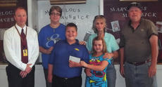 """<div class=""""source""""></div><div class=""""image-desc"""">Proceeds from the sale of cornmeal, whole wheat flour, grits, apple butter and sorghum from the Connersville Mills and Co. at the recent Taste of Harrison County was presented to Steven Fowler, back left, Southside Elementary Principal, for the Literacy Reading Program. Making the donation were, front row, from left, Johnathan William Denniston (HCMS student) and Madison Lee Denniston (Southside student), children of Jonathan Matthew Denniston, grandchildren of Johnny and Debbie (Kelly) Denniston and great-grandchildren of Sue Kelly and the late William Kelly Sr.; back row, Fowler, Trudy (Howard) Kelly, Sue Kelly and Billy Kelly. Absent were Debbie (Kelly) Denniston and Jonathan Matthew Denniston.</div><div class=""""buy-pic""""></div>"""