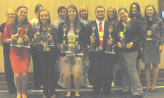 "<div class=""source""></div><div class=""image-desc"">FBLA students attending state conference were: Erin Bradford, Olivia Gasser, Elizabeth Brooks, Hunter Henson, Nelah Marsh; back row, Alyssa Fryman, Courtney Brooks, Makayla Owens, Makayla Ravenscraft, Josie Valentine, Samantha Adkins, and Michaela Bowen.</div><div class=""buy-pic""></div>"
