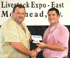 "<div class=""source"">unknown</div><div class=""image-desc"">Luke Arthur of Cynthiana, right, earned champion honors in the round-robin showmanship competition at the Kentucky Junior Livestock Expo – East on June 10 in Morehead. (Kentucky Department of Agriculture photo)</div><div class=""buy-pic""></div>"