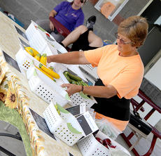 """<div class=""""source"""">Becky Barnes</div><div class=""""image-desc"""">Vickie Fryman of the Harrison County Farmers' Market arranged her produce for sale last Friday. The Farmers' Market is open on Fridays and Saturdays selling only locally produced or handmade items.</div><div class=""""buy-pic""""><a href=""""/photo_select/28123"""">Buy this photo</a></div>"""