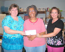 "<div class=""source""></div><div class=""image-desc"">Cynthiana Democrat representatives Becky Shepperd, left, and Pam Howard, right, presented a $495 check to Marilyn Wash of the Harrison County Food Pantry. Food items and cash were collected during the 8th annual Home and Garden Show held at the  Burley Co-op on April 30 and May 1. </div><div class=""buy-pic""><a href=""/photo_select/14167"">Buy this photo</a></div>"