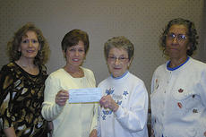 "<div class=""source"">Robin Smiley</div><div class=""image-desc"">Harrison Deposit Bank and Trust donated $500 to the Harrison County Food Pantry on Monday, Nov. 21. Presenting the check were, from left, Susan Dearborn, bank vice president and Tonya Dryden, executive vice president, to Margaret Watson and Marilyn Wash, Harrison County Food Pantry.</div><div class=""buy-pic""><a href=""/photo_select/16664"">Buy this photo</a></div>"