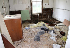 """<div class=""""source"""">Becky Barnes</div><div class=""""image-desc"""">The inside of 116 Webster Ave. was inspected by state and local leaders on Tuesday morning. Areas of the house had no flooring and walls were torn away exposing termite-riddled framework. </div><div class=""""buy-pic""""><a href=""""/photo_select/28437"""">Buy this photo</a></div>"""