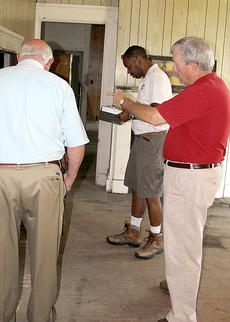 """<div class=""""source"""">Becky Barnes</div><div class=""""image-desc"""">Code Enforcement officer Wayland Quisenberry, board chairman Mike Aldridge and building inspector Isaac Hughes look at some the problem areas of the house.</div><div class=""""buy-pic""""><a href=""""/photo_select/28438"""">Buy this photo</a></div>"""