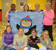 """<div class=""""source""""></div><div class=""""image-desc"""">Girl Scout Junior Troop 24 is working on their bronze awards.  Their project is Project Linus, the girls has set a goal to collect over 100 blankets. They will be placing boxes in the community for people to donate blankets. If any one in the community would like to donate a blanket contact Jennifer Fryman at jfryman2213@gmail.com. Pictured are: front row, from left, Bottom roll Madison Wade, Mallory Creech, Hope Stiltner, Jaelyn Terhune; back row, Kirsten Griggs, Alura Schaum, Brooklyn Fryman and Kaden Culberson. Absent was Allie Kearns.</div><div class=""""buy-pic""""></div>"""