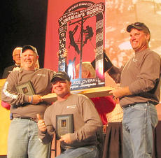 "<div class=""source""></div><div class=""image-desc"">Blue Grass Energy's team of world champion linemen (from left) Eugene Neeley, Brad Wiglesworth and Miles Shumaker on stage at the 28th Annual International Lineman's Rodeo.</div><div class=""buy-pic""></div>"
