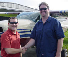 """<div class=""""source""""></div><div class=""""image-desc"""">Michael Ingram, right, with instructor Tim Pence following his Private pilot checkride.</div><div class=""""buy-pic""""></div>"""