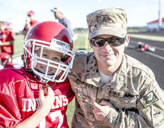 "<div class=""source"">Ryan Roush</div><div class=""image-desc"">a surprise reunion - Jayce Pickett, 9, was surprised by his father, Brandon, while at his last home football game. Brandon Pickett, originally from Cynthiana, was allowed to return home early from his post in Afghanistan. The video of his return went viral on the web.</div><div class=""buy-pic""></div>"