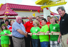 """<div class=""""source"""">Photo by Kayla Pickrell</div><div class=""""image-desc"""">Re-Dedication _ The McDonald's on US 27 South was re-dedicated Tuesday with a ribbon cutting from Mayor Steve Moses. A new drive-thru lane was built with the addition of more advanced technology. Owner Kelly Healy donated $200 to the Harrison County 4-H, and some members joined in the ceremony.</div><div class=""""buy-pic""""><a href=""""http://web2.lcni5.com/cgi-bin/c2newbuyphoto.cgi?pub=081&orig=ribbonone6.19.14.jpg"""" target=""""_new"""">Buy this photo</a></div>"""