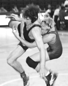 """<div class=""""source"""">Mary Charles Coy</div><div class=""""image-desc"""">Harrison County sophomore wrestler Brandon Barmett attempts to take down his opponent. Barnett leads as the only Thorobred to come away from last weekend's Region 7 Tournament as a weight class champion.He went a perfect 3-0 in the 171 weight class to ear</div><div class=""""buy-pic""""><a href=""""/photo_select/3430"""">Buy this photo</a></div>"""