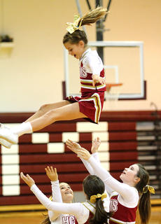 """<div class=""""source"""">Donald Richie</div><div class=""""image-desc"""">Abby Stroub drops from formation Monday as the HCMS cheer squad rallies the crowd during a boys basketball game.</div><div class=""""buy-pic""""></div>"""