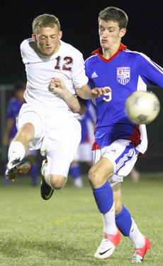 """<div class=""""source"""">Donald Richie</div><div class=""""image-desc"""">Breds senior Ben Anness kicks the ball past Montgomery County's Tanner Dice last week at the Harrison County Athletic Complex. The Breds faced off with the Indians in a rematch of last year's Region 10 finals, where Montgomery beat Harrison 1-0. This time, the Breds stepped up on defense and kept the game scoreless at 0-0.</div><div class=""""buy-pic""""></div>"""