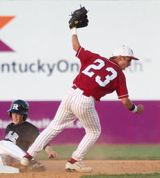 """<div class=""""source"""">Donald Richie</div><div class=""""image-desc"""">Brandon Case gets the out at second and subsequently throws to first for the play Tuesday night in the opening round of the Forcht Bank/KHSAA State Baseball Tournament. The Breds' strong defensive play kept Ryle to one run in the 4-1 win.</div><div class=""""buy-pic""""></div>"""