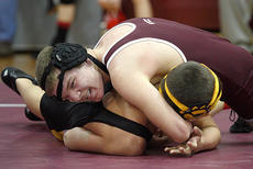 "<div class=""source"">Donald Richie</div><div class=""image-desc"">Brandon Lewis gets control of his Johnson County opponent Saturday at the middle school district wrestling tournament held at Harrison County Middle School.</div><div class=""buy-pic""></div>"