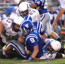 """<div class=""""source"""">Donald Richie/Richie Photography</div><div class=""""image-desc"""">The Breds defense, clockwise from top, Clay Jones, Tyler Motell and Zach Mastin, take down Mason County QB Jake O'Mara last Friday night in Mason County.</div><div class=""""buy-pic""""></div>"""