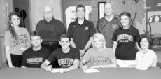 "<div class=""source"">Donald Richie</div><div class=""image-desc"">​HCHS seniors and twin siblings Grant and Haley Carr, front row, center, signed with Georgetown College last Thursday in a ceremony at Harrison County High School. Grant will run track and cross country and Haley will run track. With them at the signing were, front row, from left, their sister Mariah Carr, their father Jim Carr, their sister Kelsey Carr, their mother Angie Carr; back row, HCHS girls head track coach Danny Simpson, Georgetown track coach Todd McDaniel, and HCHS assistant track coach Harold Barnett. Absent was HCHS boys' head track coach Robert Walker. The twins will join their cousin, 2010 HCHS graduate Nick Slucher, who also runs for the Tigers.</div><div class=""buy-pic""></div>"