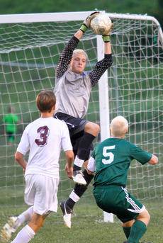 """<div class=""""source"""">Donald Richie</div><div class=""""image-desc"""">Breds keeper Christian Carey gets the block against the approaching Michael Landwehr of Bishop Brossart in the second round of play for the Thorobred Classic last Thursday at LeBus Field.</div><div class=""""buy-pic""""></div>"""