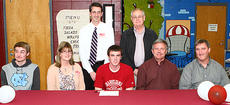 "<div class=""source"">Donald Richie</div><div class=""image-desc"">Thorobreds basketball senior Dillon Pulliam, front row center, signed to play basketball for Transylvania University last week in a ceremony at Harrison County High School. With him were, front row from left, his brother Zack, his mother Debbie, his father Bill, Breds head coach Larry Kendall; back row, assistant coaches Dr. Stephen Moses and Ronnie Spicer.</div><div class=""buy-pic""></div>"