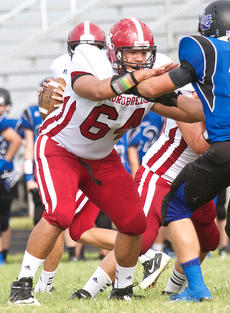 "<div class=""source"">Donald Richie</div><div class=""image-desc"">Senior Dominic Walker blocks for Thorobreds quarterback Robbie Stroub Sunday in Grant County. Harrison notched a 34-24 win over Gallatin County in the Commonwealth Counseling Bowl at Grant County High School.</div><div class=""buy-pic""></div>"