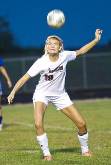 """<div class=""""source"""">Donald Richie</div><div class=""""image-desc"""">Haley Carr heads the ball last Wednesday as the Fillies played a 10-minute senior night game against Frankfort. Stormy weather caused the game tone cancelled.</div><div class=""""buy-pic""""></div>"""