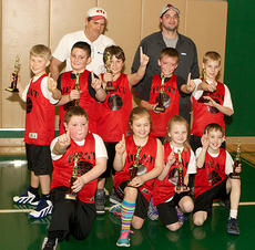 "<div class=""source"">Photos by Donald Richie</div><div class=""image-desc"">The Heat third and fourth grade basketball team won the recreation department championship tournament last week at City Hall. The 2013 team was, front row, from left, Jacob Vascotto, Alexis Wright, Emily Bradford, Ryan Anness; second row, Dillon Mains, Preston Dotson, Dalton Mattox, Haydon Edwards, Ashton Stone; back row, coaches Darrell O'Brien and Sean Espinola.</div><div class=""buy-pic""></div>"