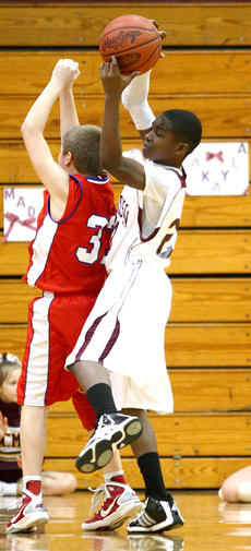 "<div class=""source"">Donald Richie</div><div class=""image-desc"">Jovon Williams grabs a Scott County Middle School rebound Tuesday night.</div><div class=""buy-pic""></div>"