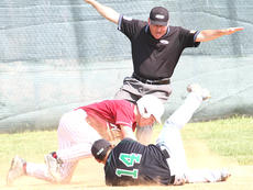"""<div class=""""source"""">Donald Richie</div><div class=""""image-desc"""">Noah Mitchell avoids the tag at third Monday in the opening game of the Region 10 Baseball Tournament on the Hilltop. The Breds beat St. Patrick 18-1 in the first round.</div><div class=""""buy-pic""""></div>"""